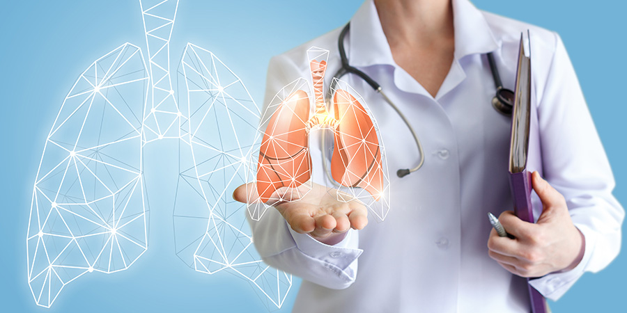 doctor holding lung graphic